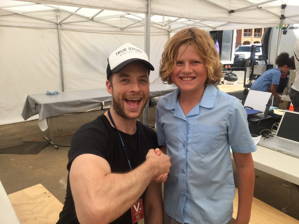 Hamish Blake with Lachlan on set for 'True Story'